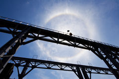 Amazing sun halo above bridge Stock Image
