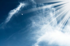 Amazing sun and moon high in  the blue sky. Royalty Free Stock Photo