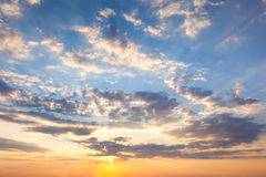 Amazing Sundown Sky with Beautiful Clouds and Sunbeams Royalty Free Stock Image