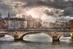 Amazing sunlight above of the Pont Louis-Philippe Royalty Free Stock Photo