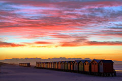 Amazing sunrise. Beach huts at the town of Muizenberg near Cape Town South Africa Stock Images