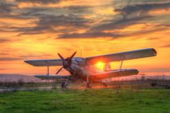 Amazing sunrise with an airplane Royalty Free Stock Photography