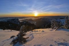 Amazing sunrise in Ceahlau mountains, winter landscape.  stock images