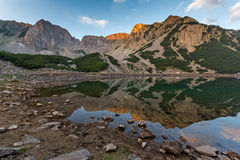 Amazing Sunrise with Colored in red rock of Sinanitsa peak and  the lake, Pirin Mountain Royalty Free Stock Images