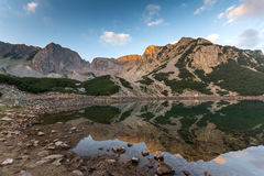 Amazing Sunrise with Colored in red rock of Sinanitsa peak and  the lake, Pirin Mountain Royalty Free Stock Photography