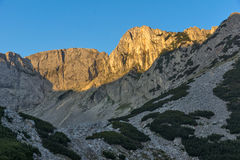 Amazing Sunrise with Colored in red rock of Sinanitsa peak and  the lake, Pirin Mountain Royalty Free Stock Photo