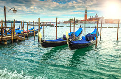 Amazing sunrise with gondolas harbor in Venice, Italy, Europe stock photography