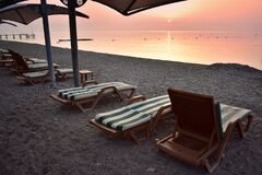 Free Amazing Sunrise In Turkey. Empty Beach Loungers Royalty Free Stock Photos - 194639668