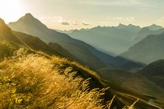 Beautiful sunrise and layered mountain silhouettes in early morning. Lechtal and Allgau Alps, Bavaria and Austria. Amazing sunrise and layered mountain royalty free stock image