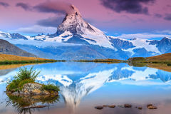 Amazing sunrise with Matterhorn peak and Stellisee lake,Valais,Switzerland. Stunning sunrise panorama with Matterhorn and beautiful alpine lake,Stellisee,Valais Royalty Free Stock Photos
