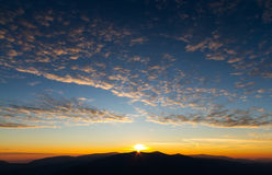 Amazing sunrise in mountains with beautiful landscape and colorfull clouds Royalty Free Stock Photos