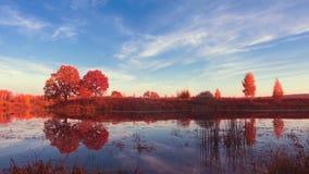 Amazing sunrise over autumn forest lake, professional time lapse.