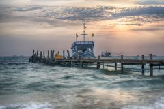 Amazing sunrise over the beach with boat royalty free stock images