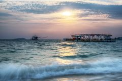Amazing sunrise over the beach with boat royalty free stock photos