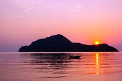 Amazing sunrise over small island Stock Image