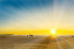 Amazing sunrise and ray of light at fishing boat Stock Images