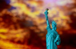 Amazing sunrise of Statue of Liberty over in new york. Orange sky, freedom, sunset, nyc, independence, usa, city, landmark, america, travel, monument, tourism stock photography