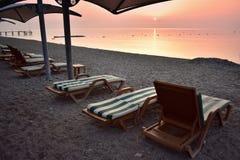 Amazing sunrise in Turkey. Empty beach loungers