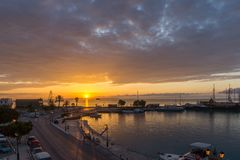 Amazing sunrise view from costal street of Zakynthos City, Ionian island, Greece. ZAKYNTHOS, GREECE - MAY 28, 2015: Amazing sunrise view from costal street of stock images
