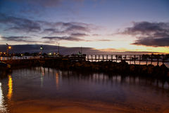 Amazing sunset along the port in San Cristobal Royalty Free Stock Images