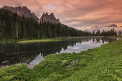 Amazing sunset and alpine lake in Dolomiti mountains,Lago di Ant Stock Photo