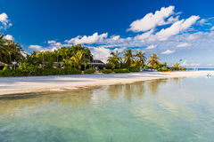 Amazing sunset beach bungalow in Maldives. Blue sky clouds and relaxing seascape Royalty Free Stock Image