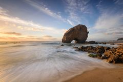 Amazing Sunset Beach on the coast of Portugal. Panoramic landscape of a holiday destination. Fine art seascape Stock Photos