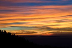 Amazing Sunset. Beautiful orange sunset with the silhouette of a small mountain Royalty Free Stock Images