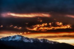 Amazing Sunset Being Pikes Peak and the Rockies Beautiful Contrast Clouds. Following a storm, the clouds broke and gave way to an amazing sunset of high contrast stock photo
