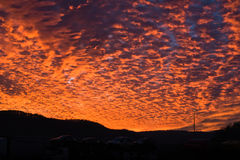 Amazing sunset with big orange fire in the sky on a road Stock Photography