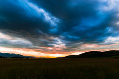 Amazing sunset. And clouds at the evening Stock Photos