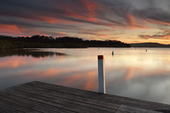 Amazing sunset colours and reflections from the timber jetty Stock Image