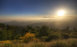 Amazing Sunset HDR near Bear Lake California. Views from the Rim of The World, California USA. Meadows with panoramic view of the mountain peaks in the fog Stock Photo