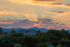 Amazing Sunset among Hills and Clouds.  Royalty Free Stock Image