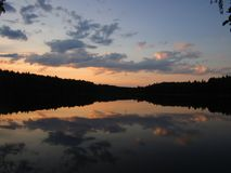 My summer vacation I spent on a forest lake, which often gives me beautiful sunsets royalty free stock photography