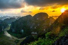 Amazing sunset landscape viewpoint from the top of Mua Cave mountain, Ninh Binh, Tam Coc, Vietnam. Amazing sunset landscape viewpoint from the top of Mua Cave stock photo