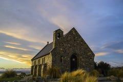 Amazing sunset at the most beautiful Church Of The Good Shepherd by Lake Tekapo, South Island, New Zealand. Dramatic sky, evening Stock Photo