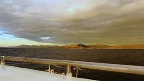 Amazing sunset in Norway with low clouds . View from yacht board. Amazing sunset in Norway with veil of low clouds close to water and earth . View from yacht stock footage