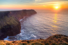 Amazing sunset over Atlantic ocean. Cliffs of Moher in Co. Clare at sunset, Ireland Stock Images