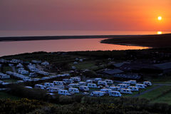 Amazing sunset over caravan park in Dorset England. Sun setting over coastal caravan park in Dorset during a stunning sunset Stock Image
