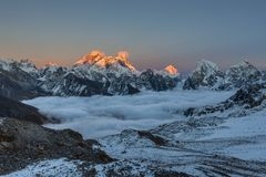 Amazing sunset over Everest summit, view from. Amazing sunset over Everest summit, view from Renjo La pass. Beautiful view of mountain valley filled with curly stock images