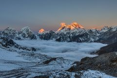 Amazing sunset over Everest summit, view from. Amazing sunset over Everest summit, view from Renjo La pass. Fair photo royalty free stock image