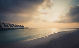 Amazing sunset over Indian ocean in Maldives stock images