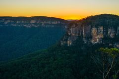 Amazing sunset over Jamison Valley in the Blue Mountains of New South Wales, Australia. Vibrant orange sunset just below the horizon line in Jamison Valley Stock Image