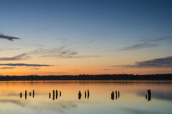 Amazing sunset over the lake with water reflections Royalty Free Stock Photography