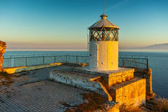 Amazing Sunset over Lighthouse in Kavala an Thassos island  in background,  Greece Stock Images