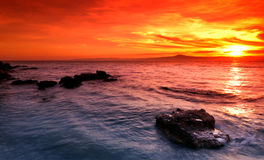 Amazing sunset over rocky seascape Royalty Free Stock Photo