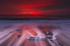 Amazing  sunset over the sea waves Stock Photo