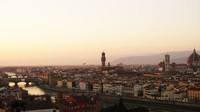 Amazing sunset panorama of Florence with Cathedral of Santa Maria del Fiore, Palazzo Vecchio Palace and Ponte Vecchio Bridge Royalty Free Stock Photos