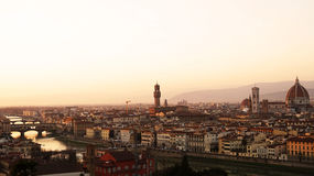 Amazing sunset panorama of Florence with Cathedral of Santa Maria del Fiore, Palazzo Vecchio Palace and Ponte Vecchio Bridge Stock Images